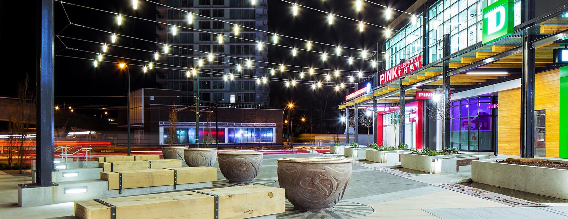 Marine Gateway plaza at night